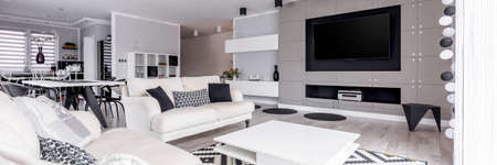 Photo pour Elegant, black and white relax zone with home cinema system - image libre de droit