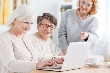 Photo for Older smart woman using new laptop on a meeting - Royalty Free Image