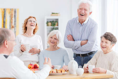 Photo pour Group of happy older people laughing together on a meeting - image libre de droit