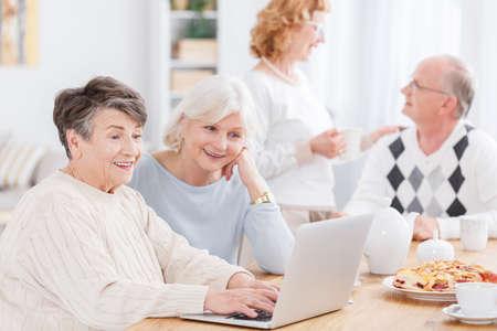 Photo pour Two senior women using new technology in nursing home - image libre de droit