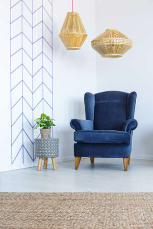 Photo for Stylish blue armchair in white living room - Royalty Free Image