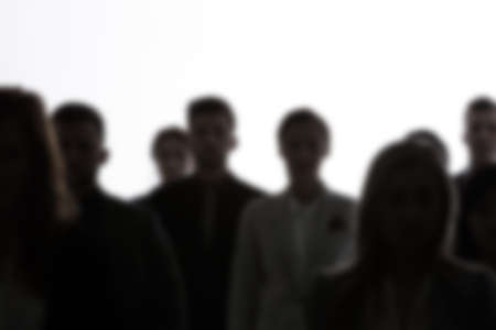 Photo pour Crowd of people silhouettes standing on white background - image libre de droit