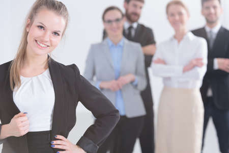 Photo for Group of young smiling professional businesspeople standing - Royalty Free Image