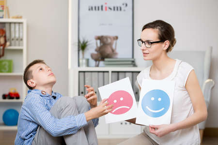 Foto de Professional psychologist working with autistic boy in her office - Imagen libre de derechos