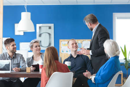 Photo for Manager talking to his colleagues during a coffee break - Royalty Free Image