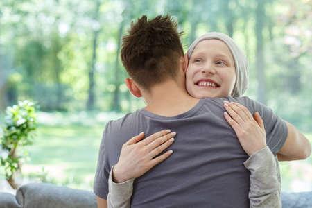 Foto de Young happy woman hugging her husband after successful therapy - Imagen libre de derechos