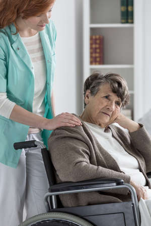Photo pour Sad old disabled lady in wheelchair feeling worse - image libre de droit