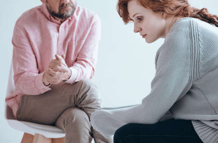 Photo pour Apathetic girl having an individual therapy with counselor - image libre de droit