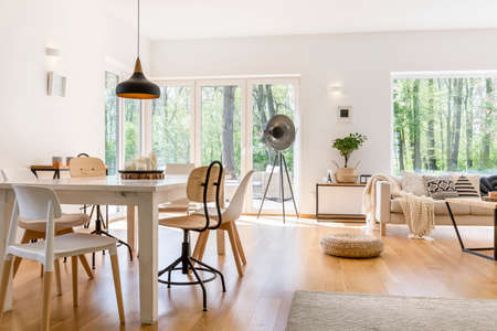Foto de Dining space with wooden table in cozy modern lounge - Imagen libre de derechos