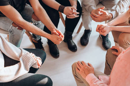 Photo pour Troubled teenagers meeting with a therapist to solve their issues,psychotherapy concept - image libre de droit