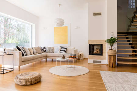 Photo for Stylish white living room with wooden stairs to the first floor - Royalty Free Image