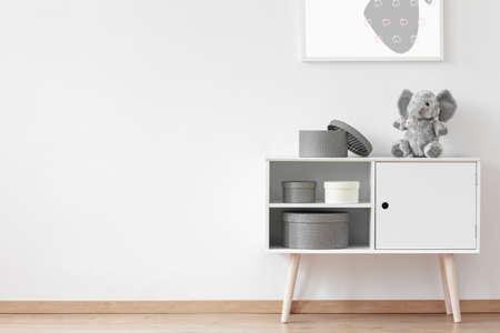 Foto de Carton round boxes standing on white wooden cupboard with stuffed toy - Imagen libre de derechos