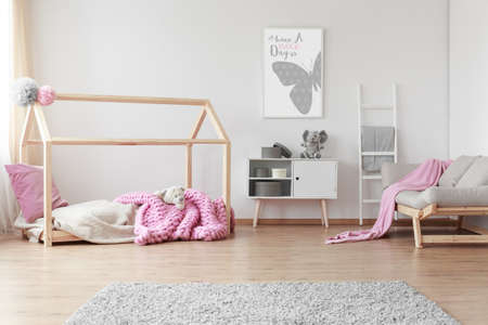 Photo pour Cozy baby girl room with positive poster of a butterfly on the wall - image libre de droit