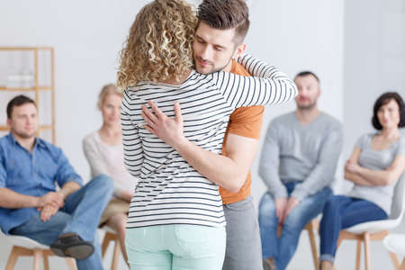 Foto de Hugging during support group meeting in rehab - Imagen libre de derechos