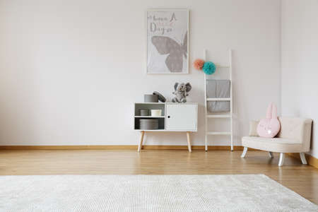 Photo for Bright spacious kid room with white cabinet and comfy sofa - Royalty Free Image