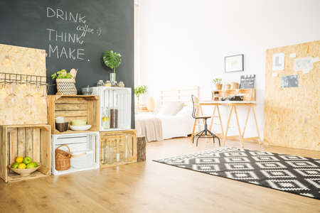 Photo pour Upcycled hipster flat with DIY wooden furniture and blackboard - image libre de droit