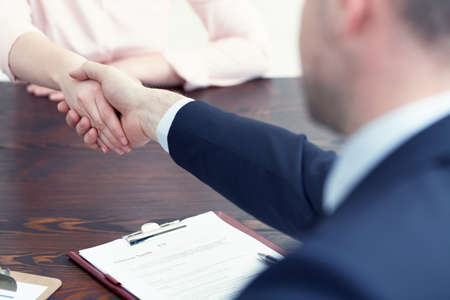 Photo for Woman getting a job after successful interview - Royalty Free Image