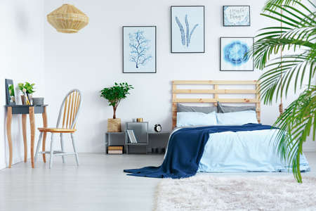Photo for Decorated white bedroom in stylish contemporary scandinavian apartment - Royalty Free Image