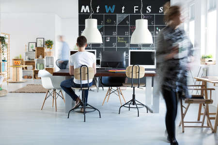 Photo pour Young coworkers in creative trendy office - image libre de droit