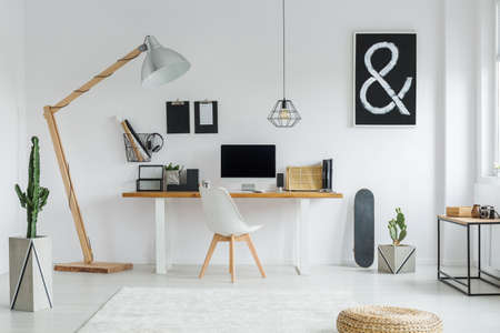 Photo for Creative designed space for work in cozy white apartment - Royalty Free Image