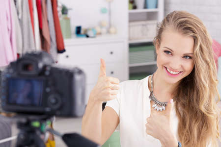 Photo for Happy vlogger enjoys work as a fashion blogger selling clothes online - Royalty Free Image