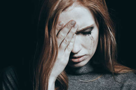 Photo pour Tears falling down the girl's cheek because of her depression - image libre de droit