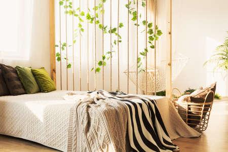 Photo pour Cozy elegant bed with colorful pillows and blanket in white eco loft - image libre de droit