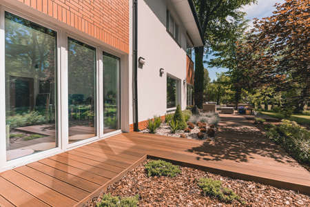 Photo pour Villa porch with glass terrace door on sunny day - image libre de droit