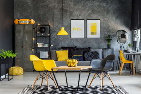 Photo pour Modern furniture in unique yellow and gray industrial office interior - image libre de droit