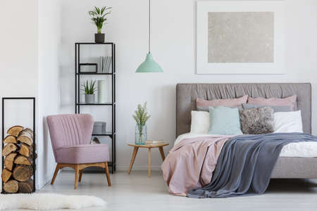 Photo pour Pink comfy armchair placed in the corner of teen girl's room - image libre de droit