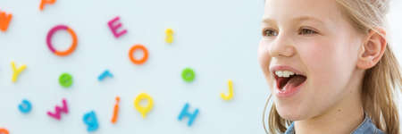 Photo for Happy,smiling child learning correct pronunciation - panorama with copy space - Royalty Free Image
