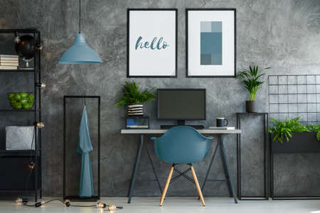 Photo for Stylish turquoise and gray interior with desk and mock-up posters - Royalty Free Image