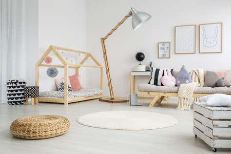 Foto de Creative scandinavian child's bedroom in modern apartment with big wooden lamp - Imagen libre de derechos