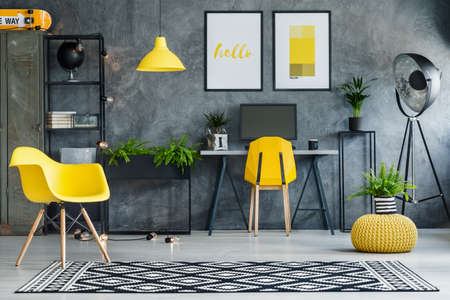 Photo pour Study space with concrete walls and yellow and metal furniture - image libre de droit