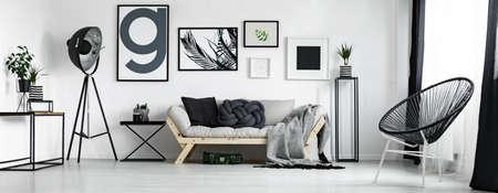 Foto de Artist's living room in minimal style with artworks - Imagen libre de derechos