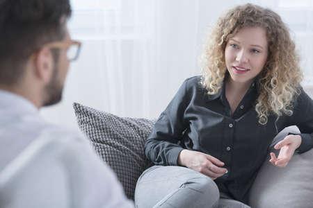 Photo pour Woman talking with psychiatrist about her getting better - image libre de droit
