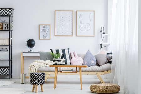 Photo pour Pastel girly room with simple sofa with decorative pillows - image libre de droit