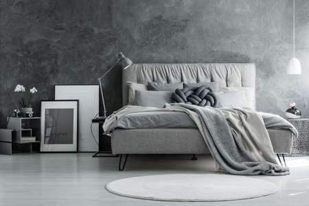 Photo for Loft style bedroom with gray design, concrete wall and modern furniture - Royalty Free Image