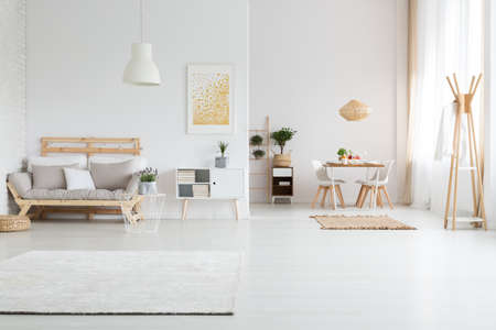 Photo for White spacious apartment with minimalist nordic living room - Royalty Free Image