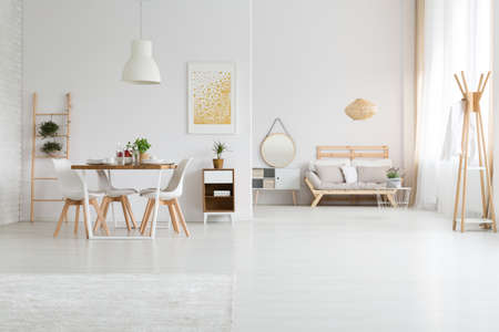 Photo pour Trendy designed dining and living rooms in white lagom style - image libre de droit