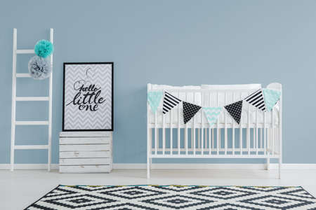 Foto für stylish minimalist baby's bedroom interior with a cute bed, small, decorated ladder, and a poster - Lizenzfreies Bild