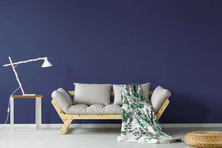 Foto de Dark blue colored living room interior in minimalistic scandi style - Imagen libre de derechos