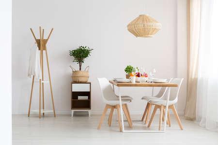 Foto de Simple stylish scandinavian dining room in minimalist white apartment - Imagen libre de derechos