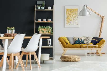 Photo pour Open space with designed furnishings and black and white walls - image libre de droit