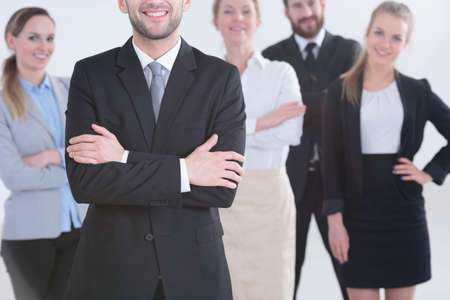 Photo for Professional smiling office workers standing in a group - Royalty Free Image