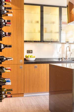 Foto de Wooden contemporary kitchen with special shelf for wine - Imagen libre de derechos