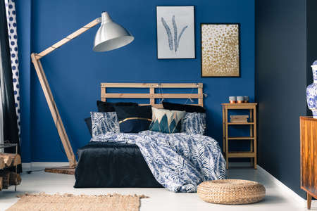 Photo pour Royal blue bedroom interior with a touch of gold - image libre de droit