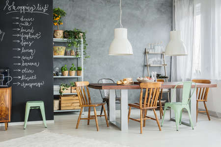 Photo for Modern dining space with shopping list on chalkboard wall - Royalty Free Image