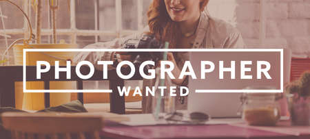 Photo for 'Photographer wanted' writing and smiling young woman looking at her camera - Royalty Free Image