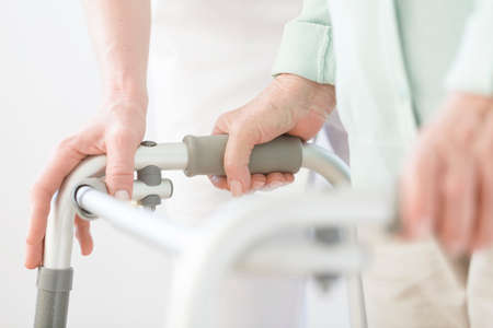 Foto de Close-up of elderly person using walker during rehabilitation at hospital - Imagen libre de derechos